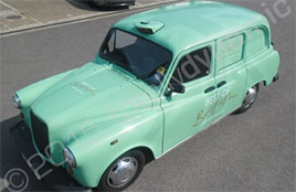 mint-green-taxi-vinyl-wrap.jpg