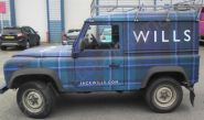 Land Rover Defender vinyl wrapped for Jack Wills in a tartan car wrap