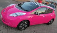 Nissan Leaf fully wrapped in a colour-matched pink vinyl car wrap