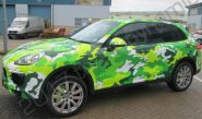 Porsche Cayenne vinyl wrapped in a printed green camouflage design