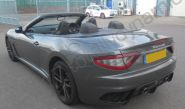 Maserati GT fully vinyl wrapped in a gloss metallic grey car wrap