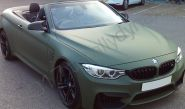 BMW M4 fully vinyl wrapped in a matt military green car wrap
