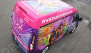 Ford Transit fully vinyl wrapped for Angels Fancy Dress in a printed van wrap design by Totally Dynamic North London