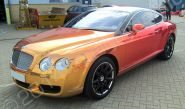 Bentley Continental GT fully wrapped in a printed chrome vinyl vehicle wrap by Totally Dynamic North London