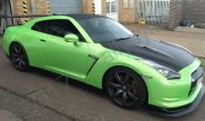 Nissan GTR vinyl wrapped in a pearlescent green car wrap with carbon fibre vinyl detailing