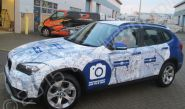BMW X3 fully vinyl wrapped for Breckon & Breckon in a printed vinyl car wrap design by Totally Dynamic South London