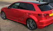 Audi S3 fully wrapped in a red chrome vinyl car wrap