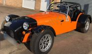 Caterham vinyl wrapped in a gloss orange car wrap