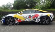BMW i8 fully vinyl wrapped for Cosatto in a printed vehicle wrap design by Totally Dynamic Manchester